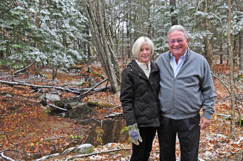 Lisa and John Rosmarin pose for a portrait on Friday on land in Readfield that they donated to the Kennebec Land Trust.