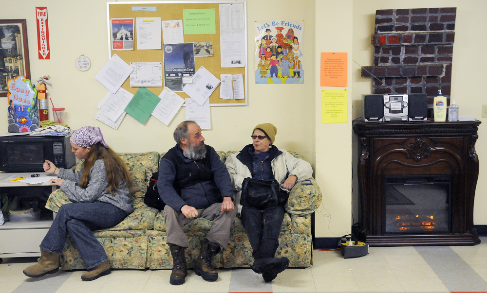 Guests socialize Thursday at the Augusta Community Warming Center in Augusta, which is run by the United Way of Kennebec Valley.