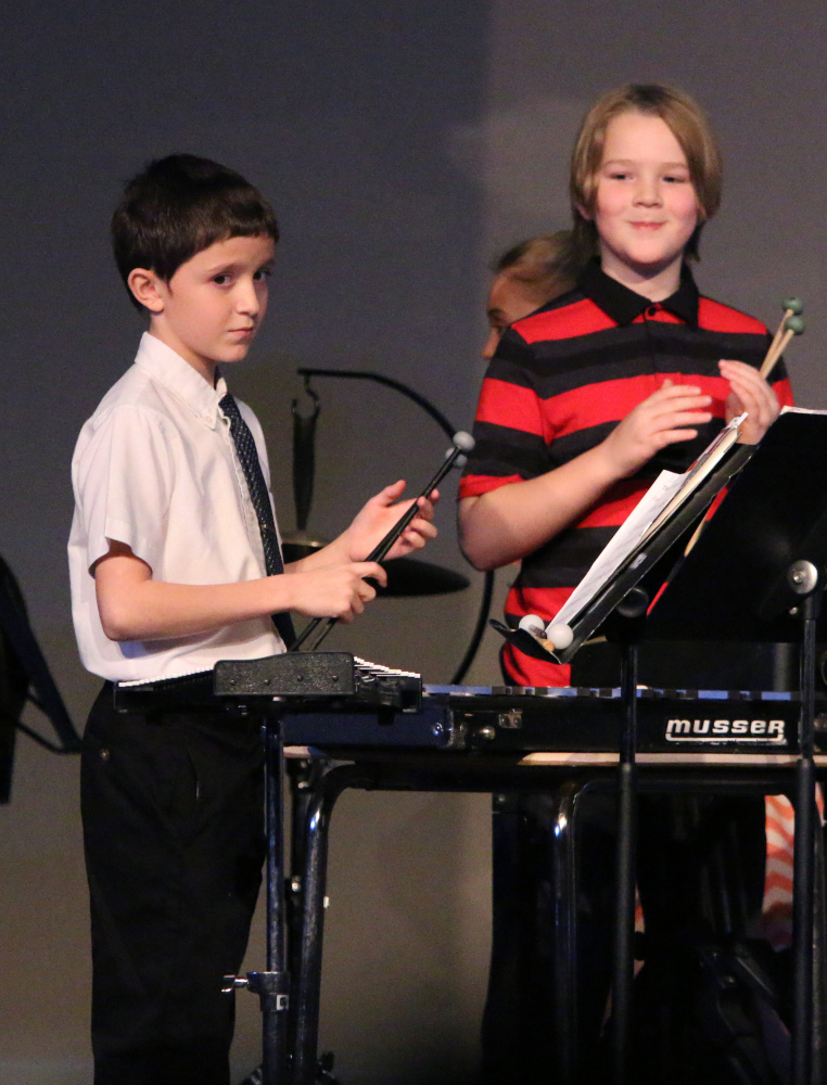 Trey Bard, left, and Rylan Richards on Percussion during Benton Elementary's Holiday Concert on De. 15.