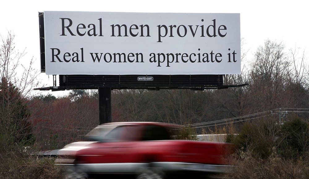 """The billboard between Winston-Salem and Greensboro reads, """"Real men provide. Real women appreciate it."""" Women are planning to protest the message Sunday."""