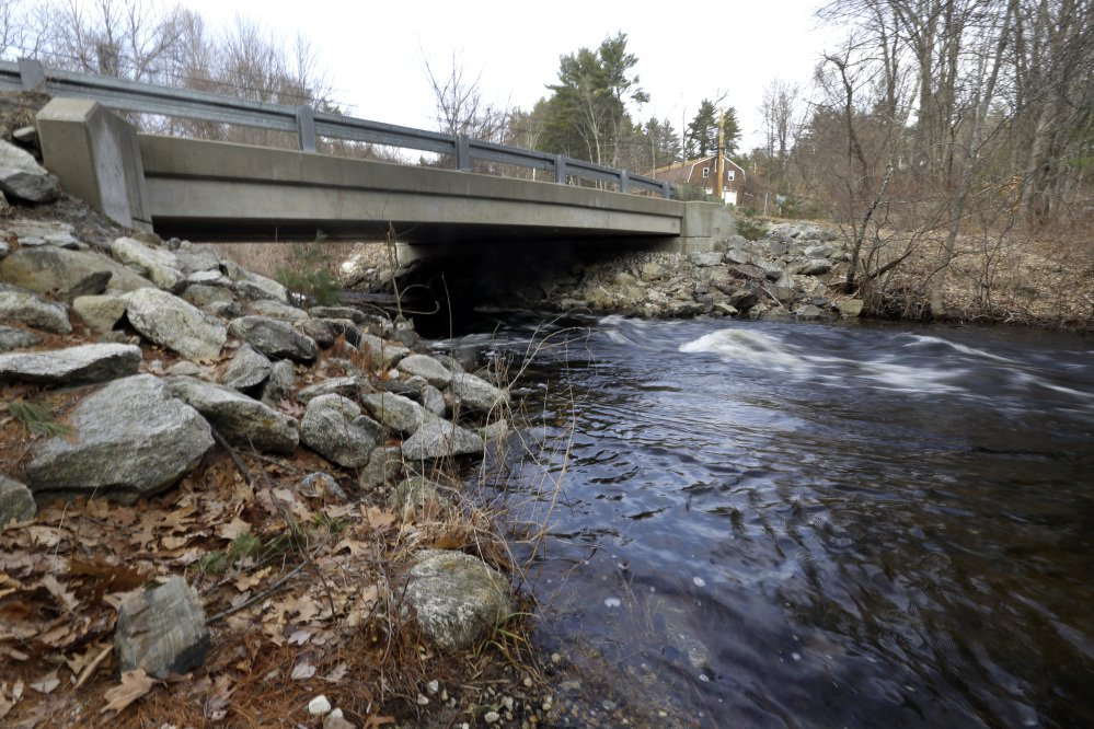 """Beaver Brook flows under a bridge closed to traffic Tuesday in Pelham, N.H. Gov. Chris Sununu pledged to invest millions of dollars in repairing roads, bridges and schools in his budget address. Some 344 municipal bridges on the state's """"red list."""""""