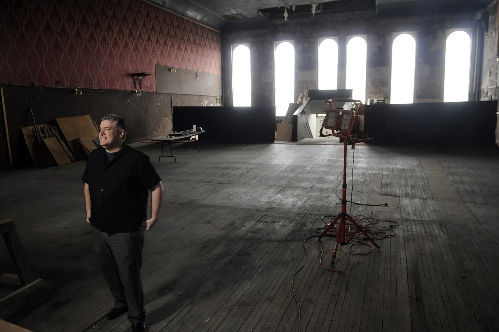 Mike Miclon, executive artistic director of Johnson Hall, stands in the third-floor theater space that he and others are working to raise money to renovate at Johnson Hall in Gardiner.