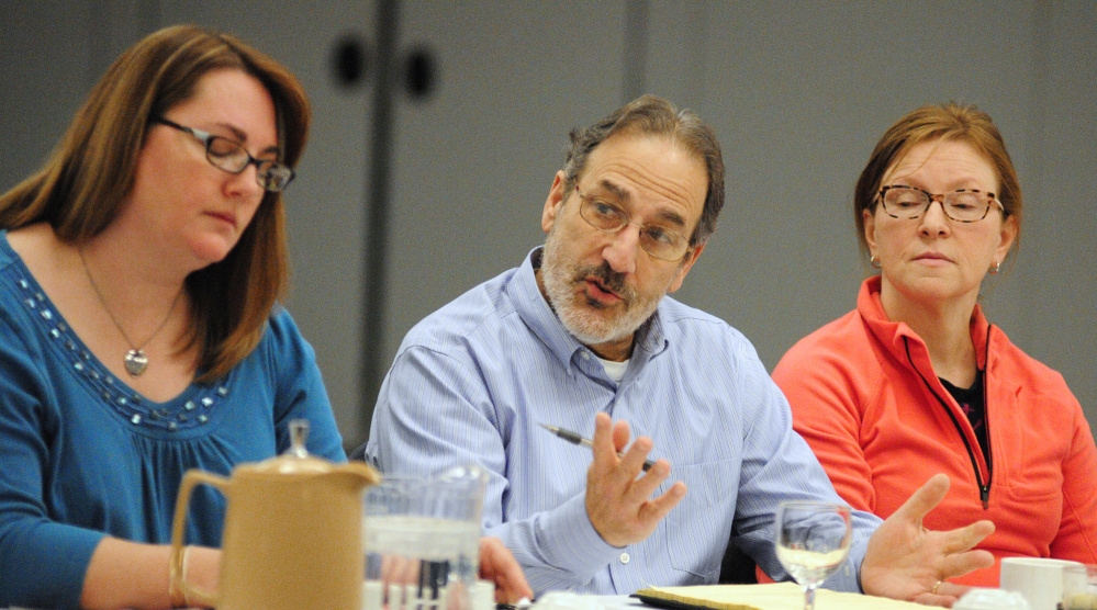 Augusta Board of Education Chairwoman Kim Martin, left, listens as School Superintendent James Anastasio speaks during the annual City Council goal setting meeting Jan. 28 at the Augusta Civic Center. At-Large City Councilor Marci Alexander is at far right.