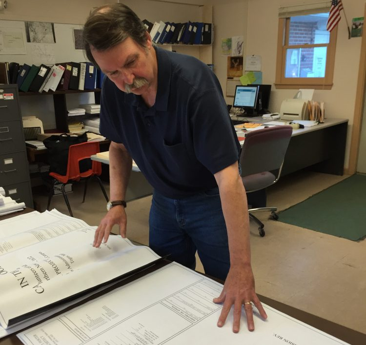 Bill Butler, the code enforcement officer for the town of Chelsea, reviews the plan for the Cabin in the Woods project for homeless veterans in 2016.