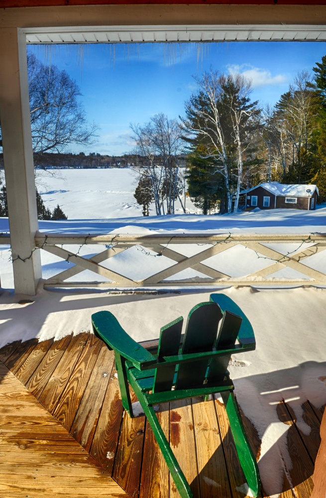 The view from the porch of lodge at Snow Pond Center for the Arts is seen Thursday. Christa Johnson, director of development at the center, said that the porch overlooking the lake is usually where a bar is set up for events.