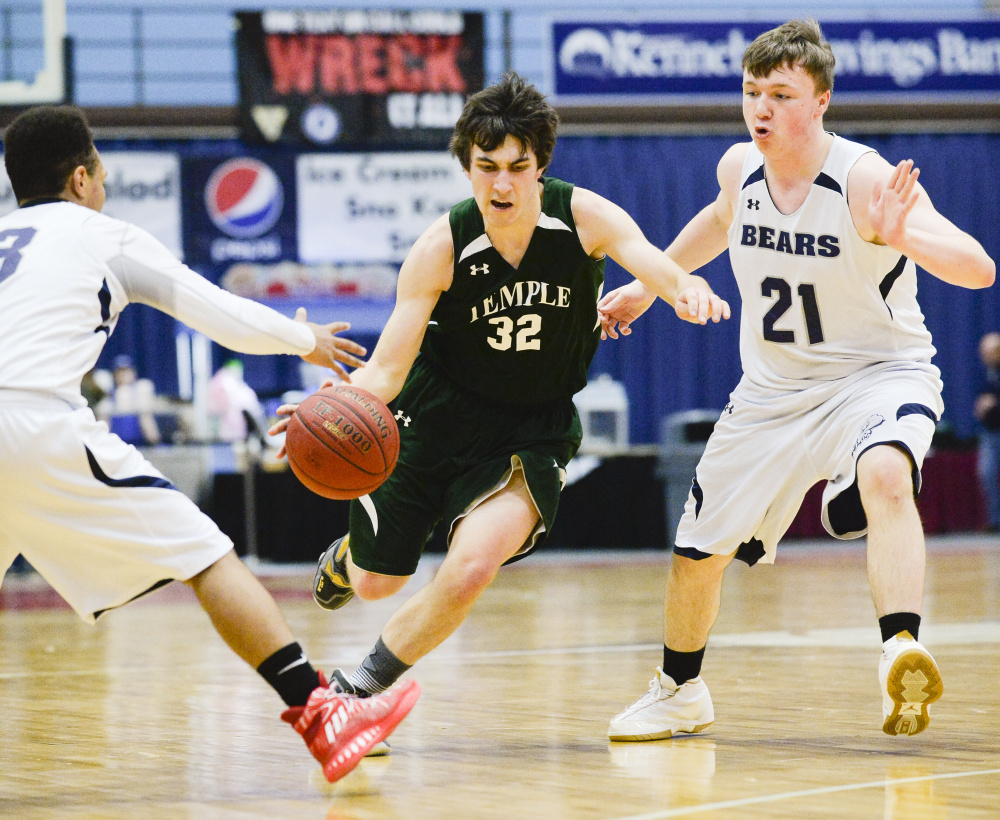 Temple's Nathaniel Wells dribbles between A.R. Gould defenders Tyrese Collins, left, and Adam Black in the second half of a Class D South quarterfinal game Saturday morning at the Augusta Civic Center.