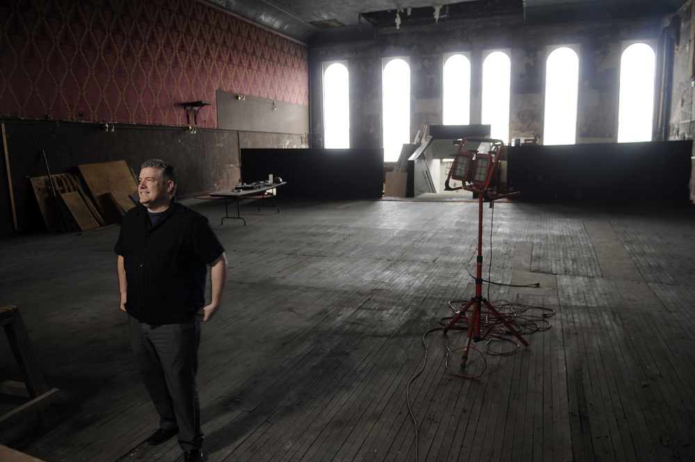 Johnson Hall's Executive Artistic Director Mike Miclon stands in 2014 on the third floor of the downtown Gardiner building's upstairs theater, which he and others hope to renovate into a performance space that will open to the public in 2019.