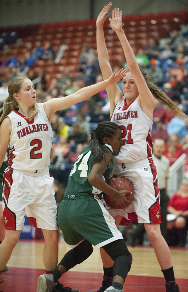 Temple's Selam Heinrich runs into a defensive wall created by Vinalhaven's Gilleyanne Davis-Oakes, right, and Ashlyn Littlefield during a Class D South semifinal Thursday at the Augusta Civic Center.