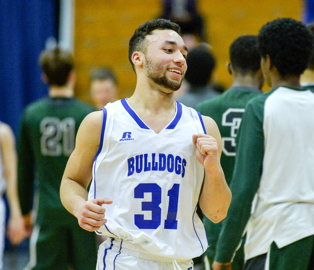 Madison's Morales fist-pumps after a stunning 52-47 win over Waynflete Thursday in a Class C South semifinal. Morales scored 18 points.