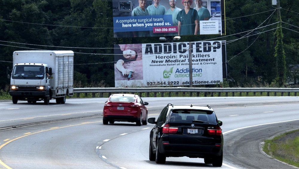 A billboard near Chillicothe, Ohio, advertises help for those addicted to opioids. Ohio is among many states, including Maine, where drug addiction and overdose deaths have skyrocketed in the past decade.