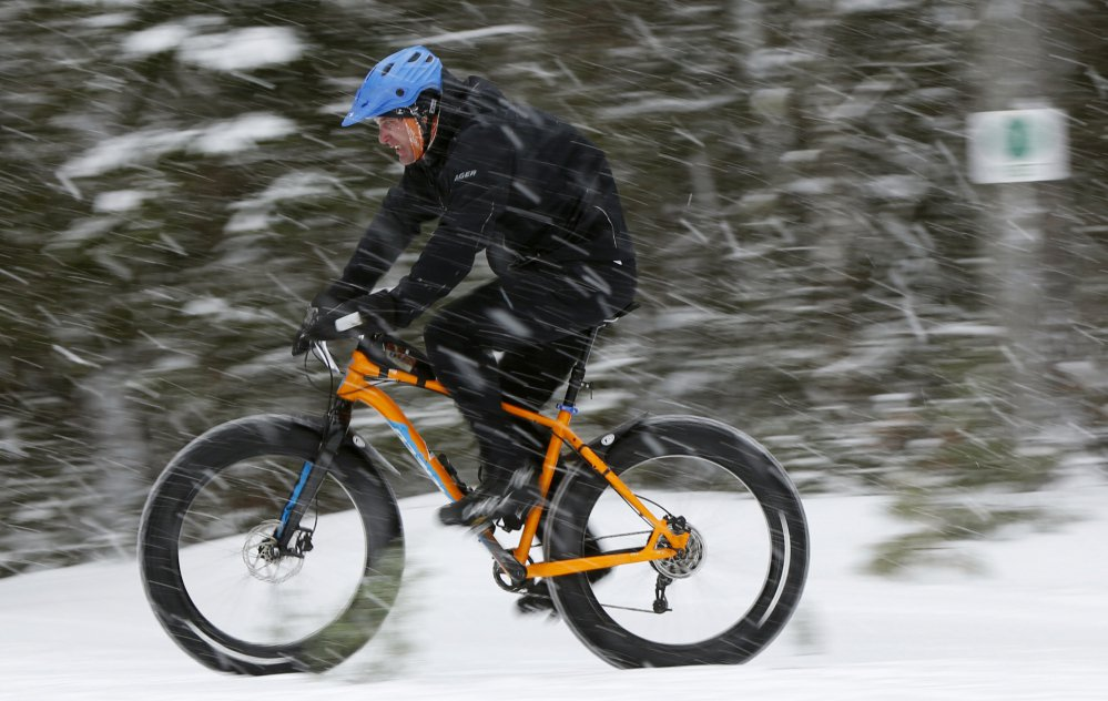 A fat tire bicyclist rides on a cross country ski trail during a race at the Sugarloaf ski resort in Carrabassett Valley. The mountain bikes with comically large tires have been around for a decade, but they've come into the mainstream in the past five years. Research firm The NPD Group says sales have grown eightfold over the past three years.