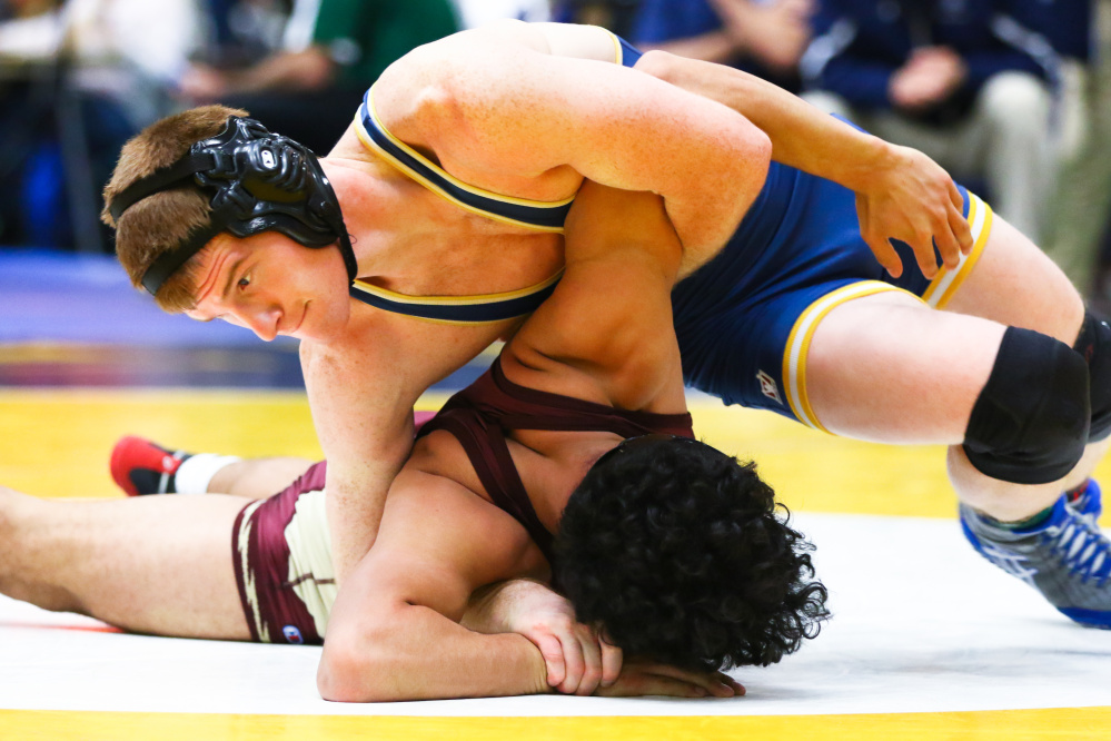 Dan Del Gallo, of the University of Southern Maine, wrestles Walter Ordnez of Springfield Technical during a match this season.