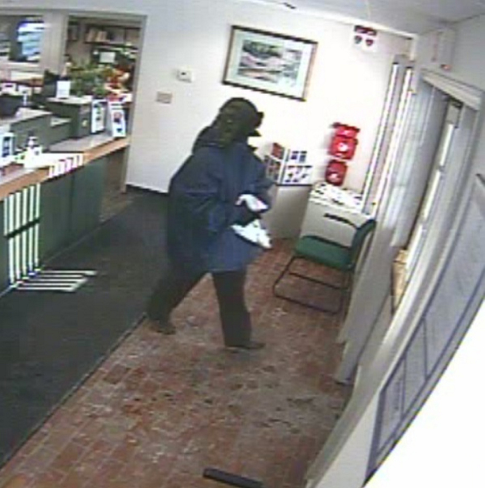 """An image released by authorities of the """"Silent Bandit"""" who has been linked to four bank robberies in central Maine in recent years."""