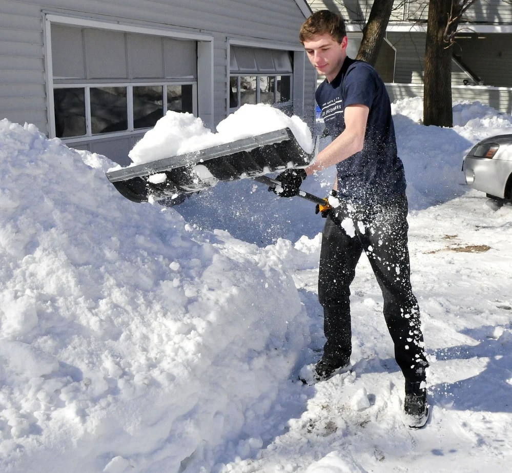 """Kyle Howard needed to wear only a T-shirt while shoveling snow Wednesday. """"It got so warm today I took off my coat,"""" Howard said."""