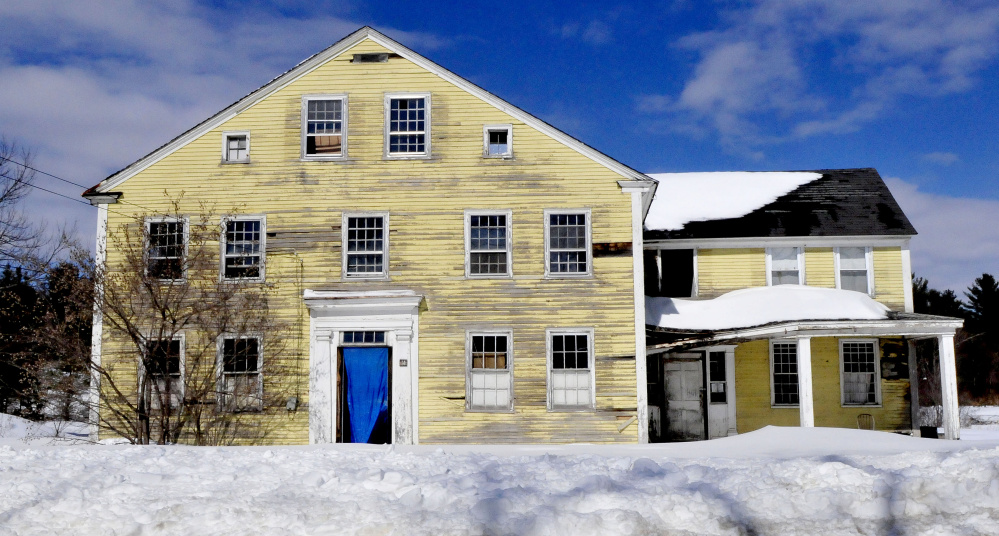 The town of Norridgewock plans to demolish this vacant house at 14 River Road because it has been deemed a safety hazard.