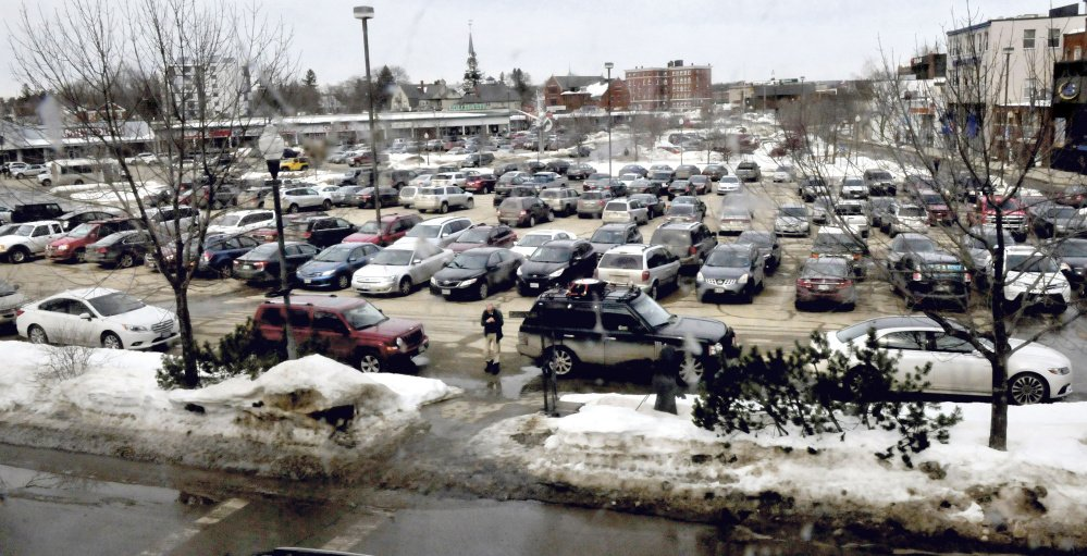 Staff file photo by David Leaming Vehicles fill The Concourse in Waterville, on Feb. 22. The impending construction of a dormitory and retail building at the north end of the site is expected to displace 90 parking spaces.