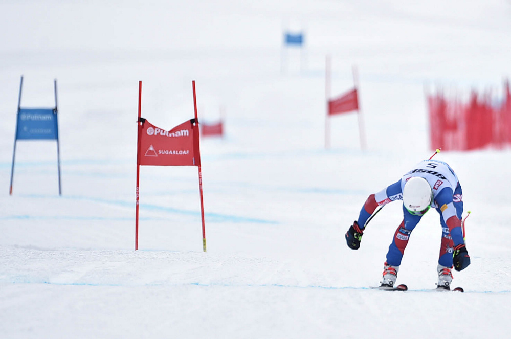 Laurenne Ross reaches for the finish line for the win in the super-G in the U.S. Alpine Championships at Sugarloaf on Saturday in Carrabassett Valley.