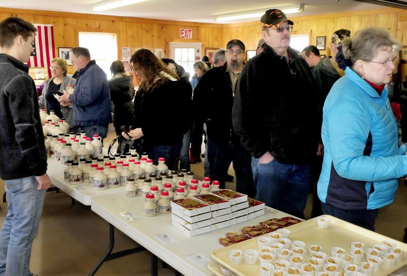 People filled a building at Strawberry Hill Farm in Skowhegan on Maine Maple Sunday to sample and purchase maple products.