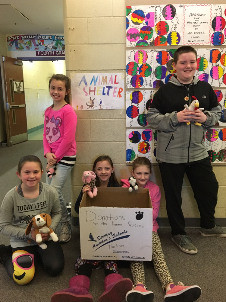 A group of fourth-grade students from Crystal Pomerleau's class with their sign and donation box for the Humane Society Waterville Area. From left are Abby Chartrand, Maya Veilleux, Maya Lavallee, Haidyn Parlin and Hunter Ward.