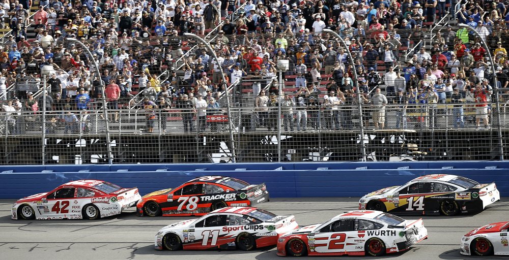 Martin Truex Jr. (78) trails eventual winner Kyle Larson (42) on the penultimate lap, as Clint Bowyer (14) and Brad Keselowski (2) pass Denny Hamlin (11) and Truex for Keselowski to finish in second place during the NASCAR race Sunday at Auto Club Speedway in Fontana, California.