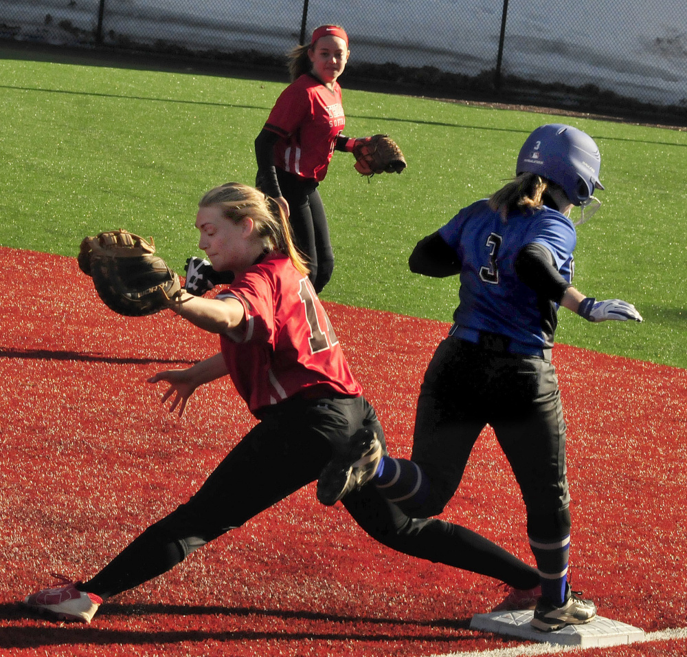 Thomas first baseman Korrie Laren makes the play as Colby's Robin Spofford runs through the bag Thursday in Waterville.