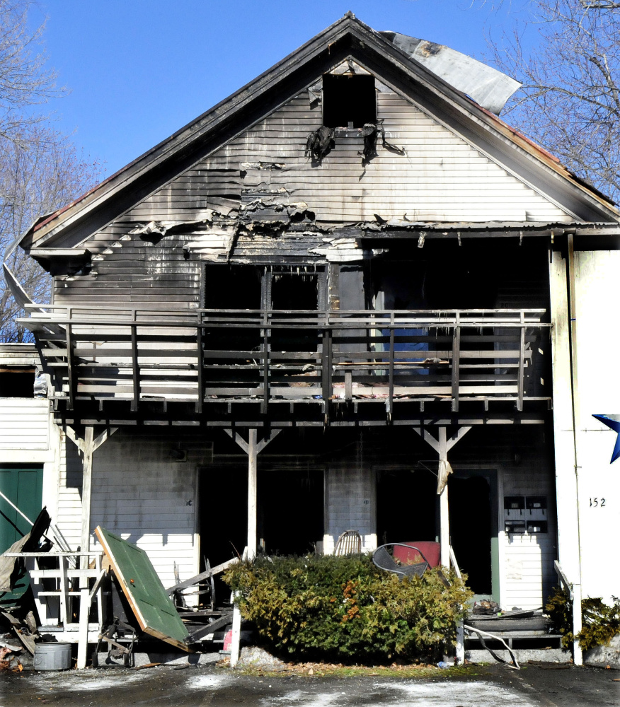 The charred remains of several efficiency apartments were still standing March 5 after fire destroyed part of the building at 152 Main St. in Madison. The Office of State Fire Marshal has determined a human element caused the fire.