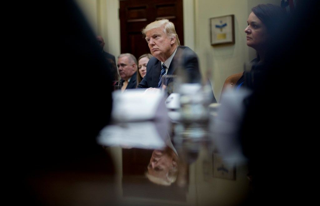 President Trump listens during a meeting on healthcare in the Roosevelt Room of the White House on March 13.
