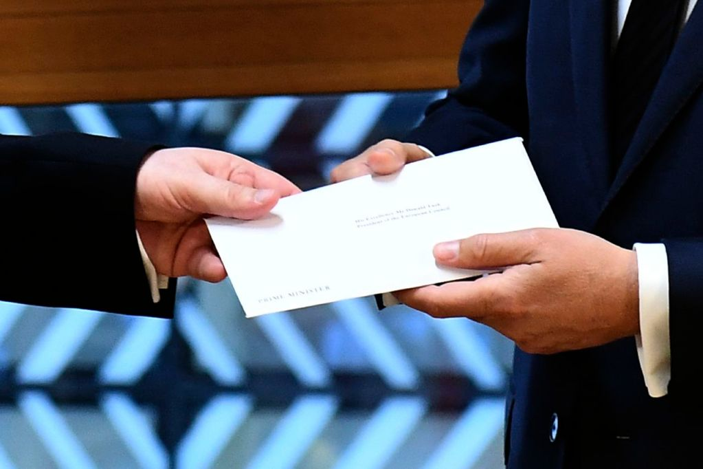 UK Permanent Representative to the EU Tim Barrow hand-delivers the letter signed by Britain's Prime Minister Theresa May that formally triggers the beginning of Britain's exit from the European Union. Receiving the letter, right, is EU Council President Donald Tusk.