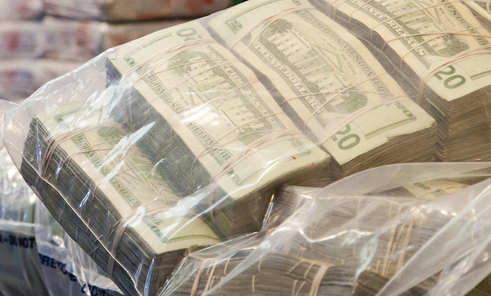 While the DEA had a warrant when it seized these sacks of money during a heroin trafficking investigation, a Justice Department report says the DEA also seizes and keeps cash unrelated  to any new or ongoing criminal investigation.