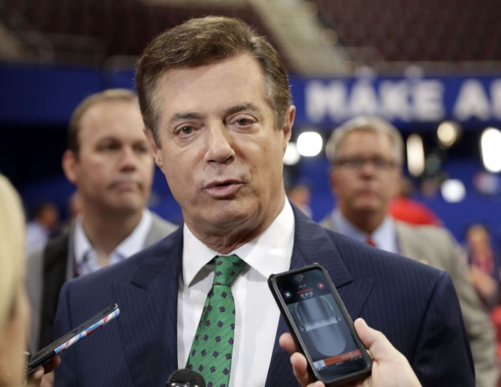Paul Manafort talks to reporters on the floor of the Republican National Convention in Cleveland on July 17, 2016. Manafort worked as Trump's unpaid campaign chairman last year from March until August. Trump asked him to resign after it was revealed that Manafort had orchestrated a covert Washington lobbying operation until 2014 on behalf of Ukraine's ruling pro-Russian political party.