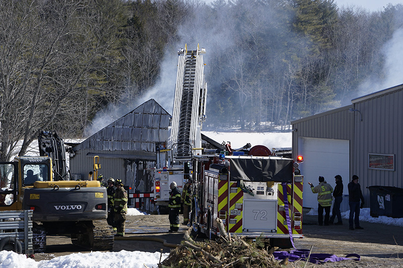 Firefighters at the scene of the barn fire on Simpson Road in Saco.