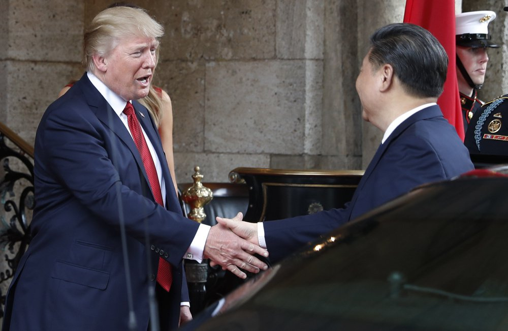 "President Trump greets Chinese President Xi Jinping at Mar-a-Lago resort, in Palm Beach, Fla., on April 6. On Thursday, he hailed the Chinese leader as ""a terrific person"" and ""a very special man."" Once soft on Russia and hard on China, Trump is changing his views on these world powers."