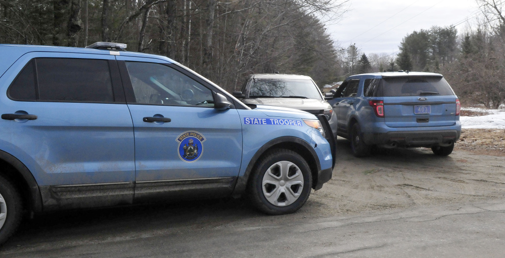 Maine State Police cruisers stand parked at the end of a driveway along South Horseback Road in Burnham while police investigate the death of Joyce Wood early Sunday morning in a house on that road.