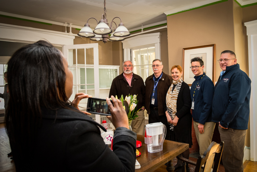 Andrea Tolbert, left, of the Portland Veterans Center, takes a photo Thursday at an open house at the Betsy Ann Ross House of Hope in Augusta. From left aree Larry Duquette, of the VA Maine Healthcare Systems-Togus; Michael Tilton, of Veterans, Inc., in Lewiston; Martha St. Pierre, Betsy Ann Ross House founder; and Alley Smith and Leo Deon, of Veterans, Inc.