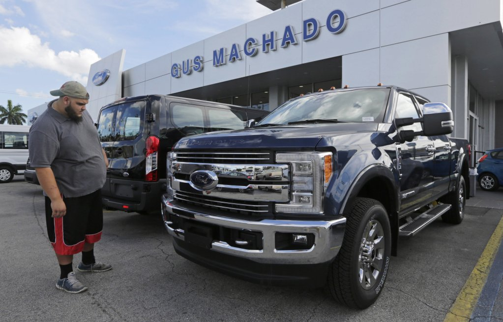 A potential customer looks at a 2017 Ford F-250 Lariat at a dealership in Hialeah, Fla., on Jan. 17.