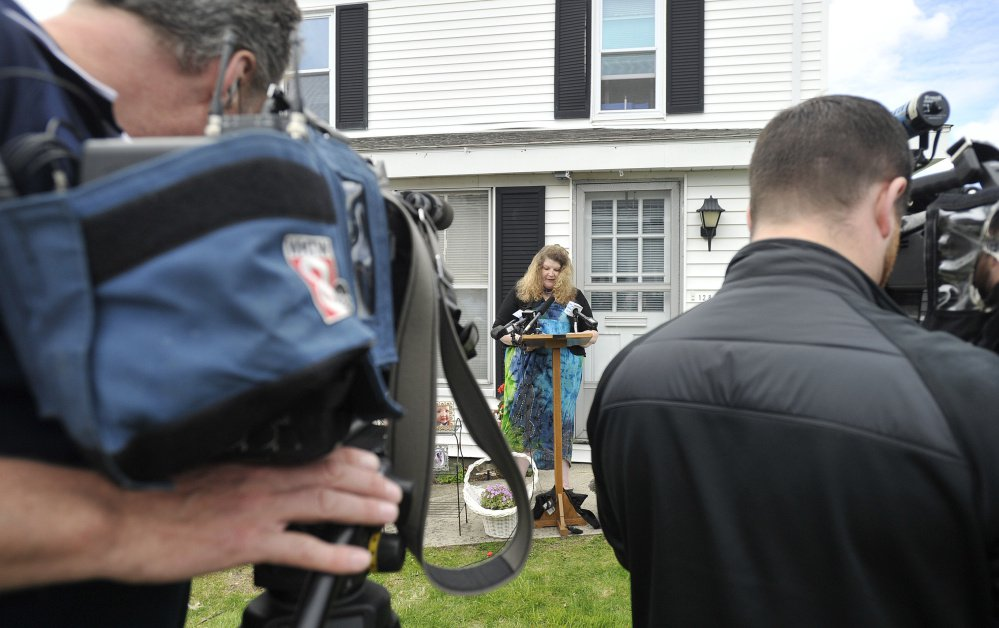 Outside the Portland home of state Rep. Diane Russell, Sandra Scribner Merlim of Naples talks Wednesday about her husband, Otto Morales-Caballeros, who is awaiting deportation.