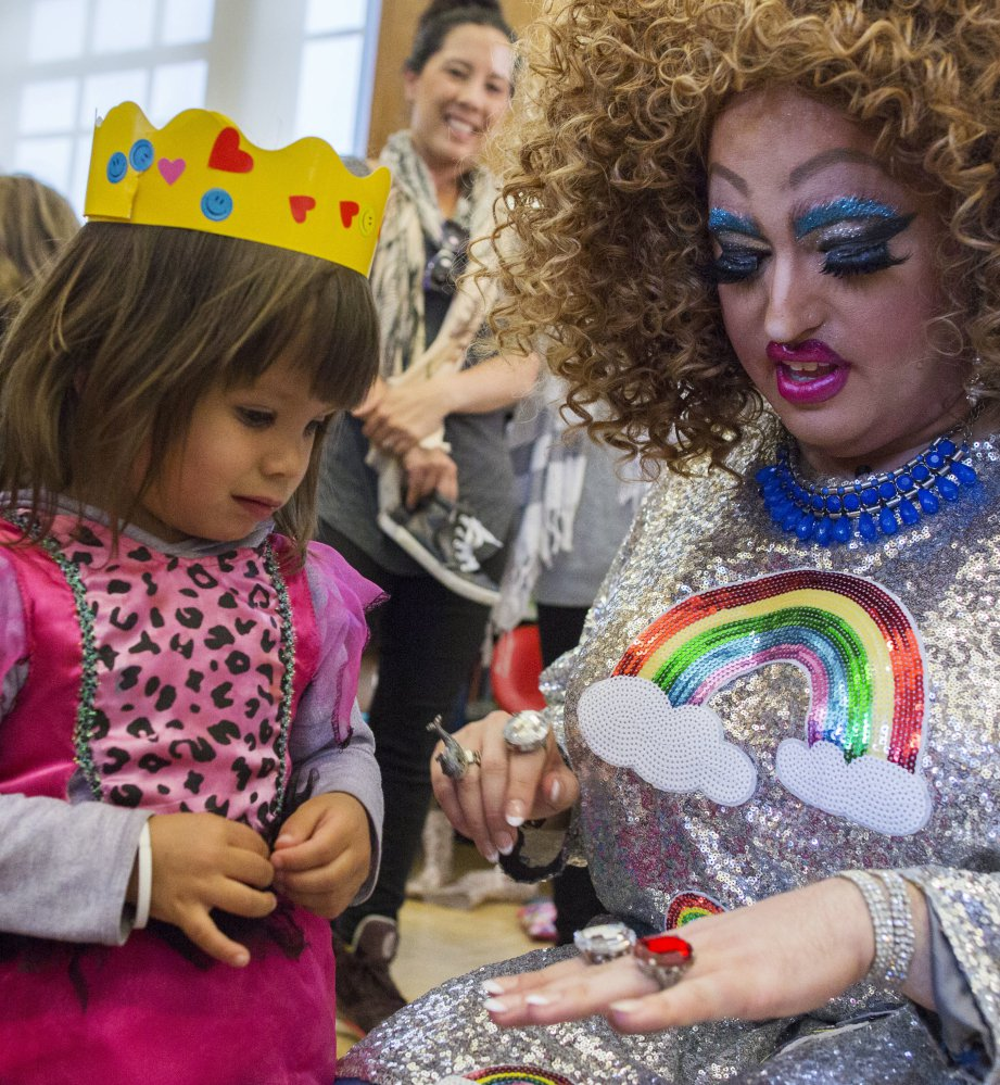 Lil Miss Hot Mess, right, compares outfits with Eva McInnes, 2, after Drag Queen Story Hour Tuesday.