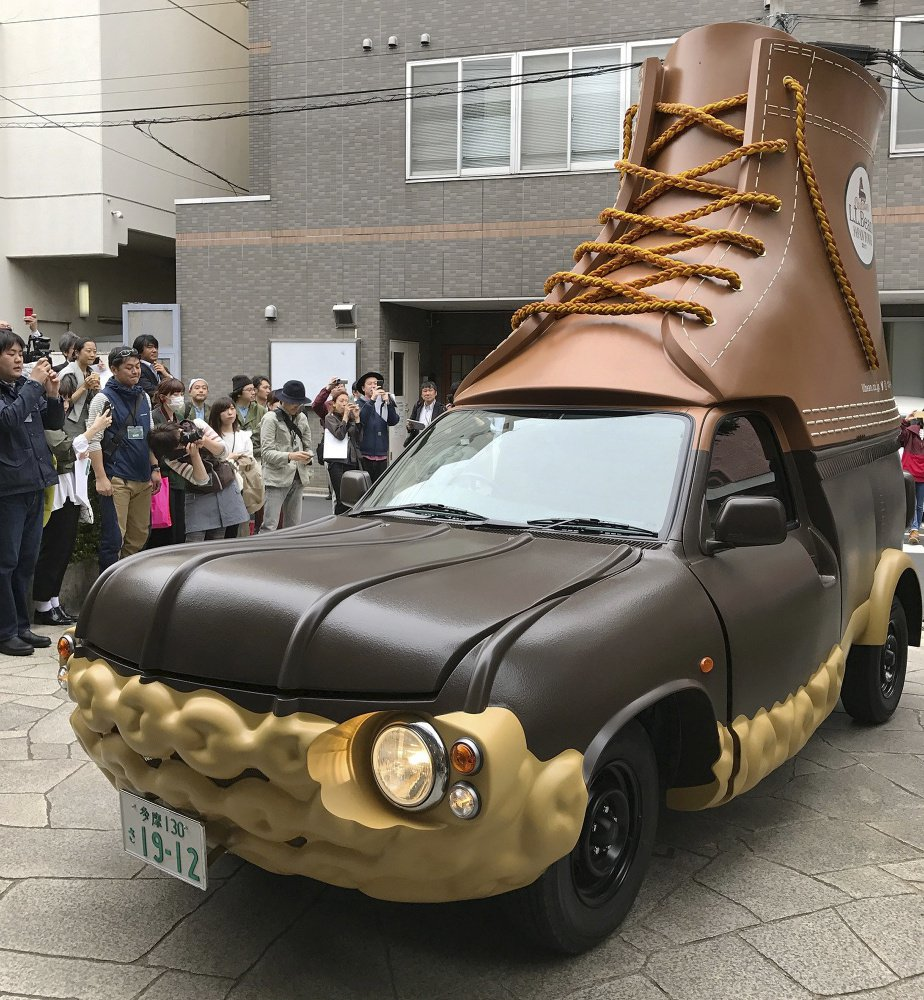 In this April 26, 2017 photo provided by L.L. Bean, the company's Bootmobile is displayed in Tokyo, Japan. The Maine-based outdoors company already has two of the rolling Bean boots in the U.S. Now this third version will be visiting Bean's stores in Japan.