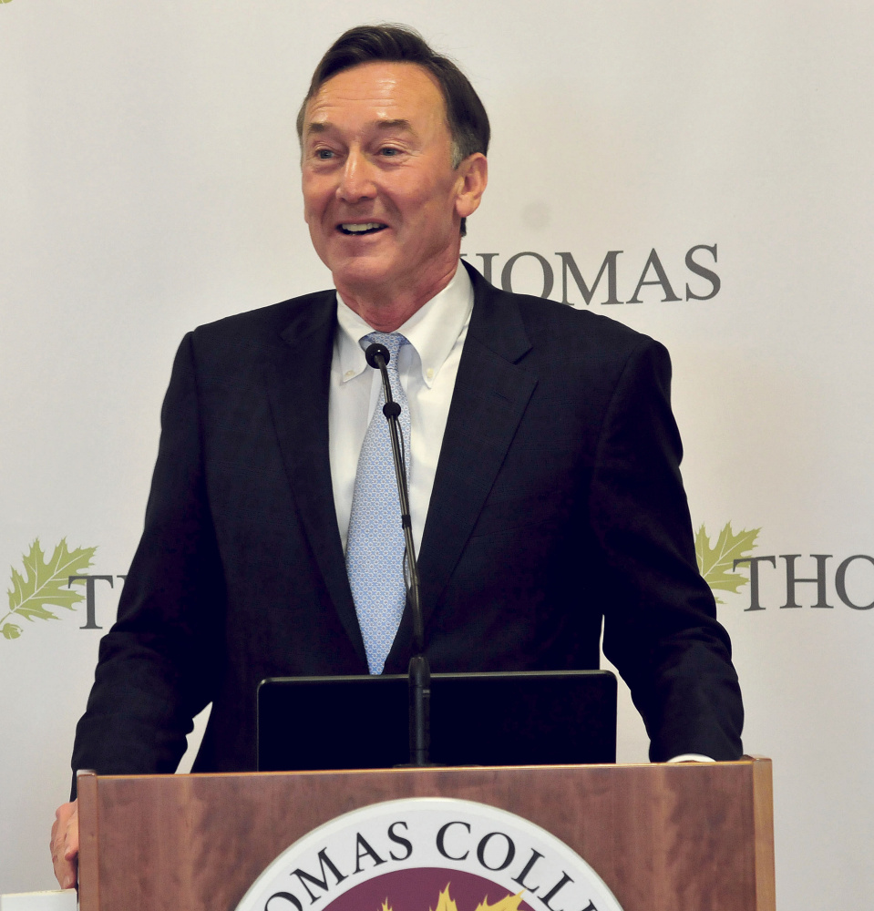 Greg Powell, chairman of the Alfond Foundation, announces Wednesday at Thomas College that the Waterville college would receive $5.3 million for the new Harold Alfond Institute of Business Innovation.