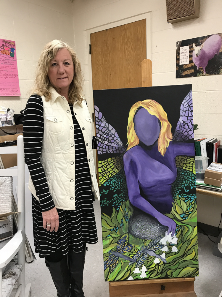 Artist and teacher Sonja Eustis Johnson with her painting, an acrylic psychological self-portrait; one of the images that will be on display at the inaugural show of the Lakeside Contemporary Art Gallery, 5-7 p.m., May 27, in Rangeley. The show will feature original artwork created to embody the concepts for instruction while encouraging a creative approach to problem solving and advancement of artistic voice to her students in five different instructional units. Student work from these units will also be on display.
