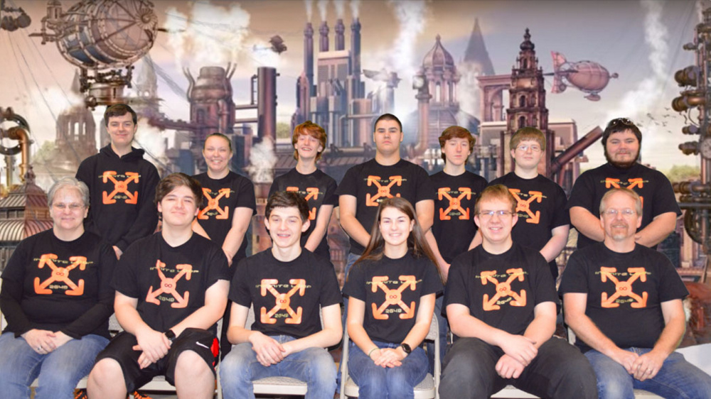 The Infinite Loop team for this school year poses for a photo. In the front row, from left, are Coach Lisa Klein, Michael Viens, Vann Guarnieri, Chelsea Perry, Ethan Pullen and Coach Keith McGlauflin. In the back row, from left, are mentor Brandon Belanger, Victoria Christianson, Kody King, Delsin Klein, David Hreben, Kai McGlauflin and mentor Justin Shuman. T.J. Petrill is not pictured.