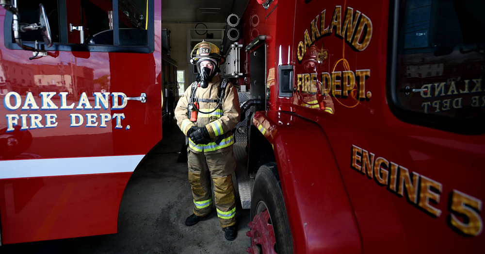 Oakland firefighter Randy Marshall stands wearing the current breathing apparatus that will soon be replaced in Oakland on Saturday.