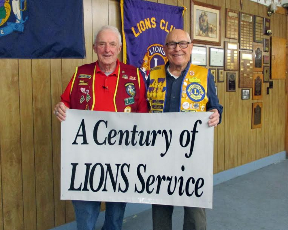 Manchester Lions Club Past District Governor Don Taylor, left, and Past Vice District Governor Al Godfrey from the Jay-Livermore Falls Lions Club, recently were recognized for 50 years of Lions service. They also celebrated a Century of Service.