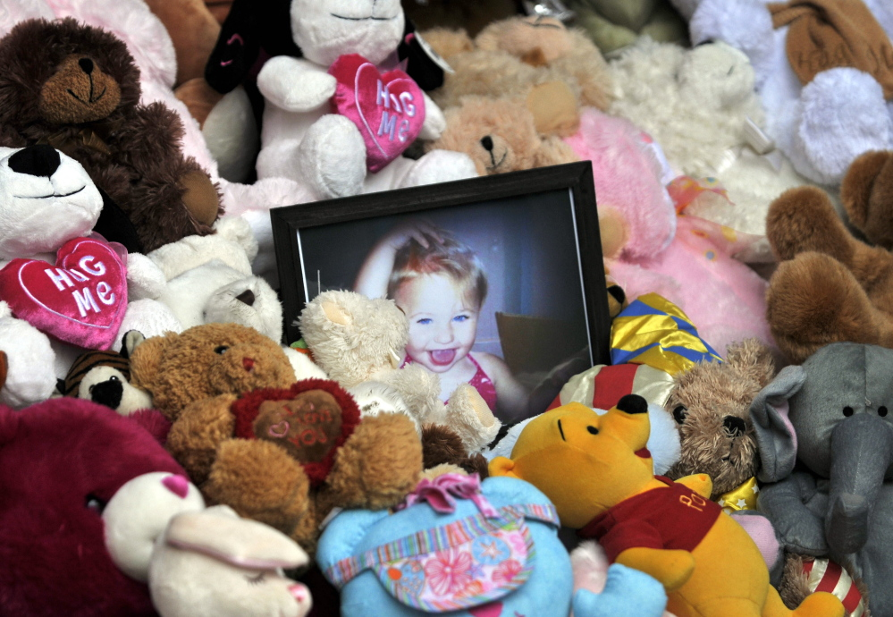 A picture of Ayla Reynolds sits among a shrine of teddy bears in 2012 on the steps of the Waterville City Hall during a vigil for the missing toddler at Castonguay Square in downtown Waterville.