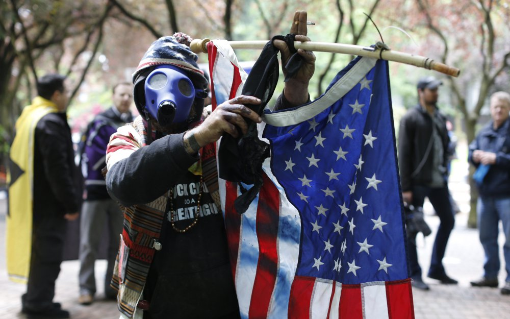 """John Durano, protesting Sunday in Portland, Ore., said he flew in from Los Angeles to demonstrate his white pride. One group said it was there to wake up the liberty movement, and another held signs declaring """"Our city is greater than hate."""""""