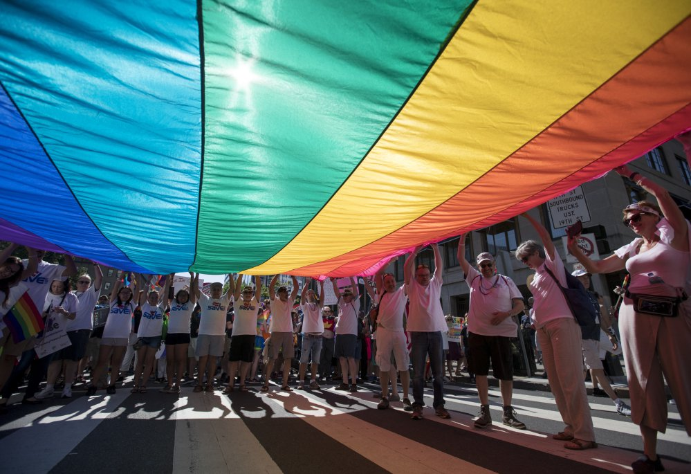 Marchers unfurl a huge rainbow flag as they prepare to march in the Equality March for Unity and Pride in Washington in 2017. Thousands paraded past the White House.