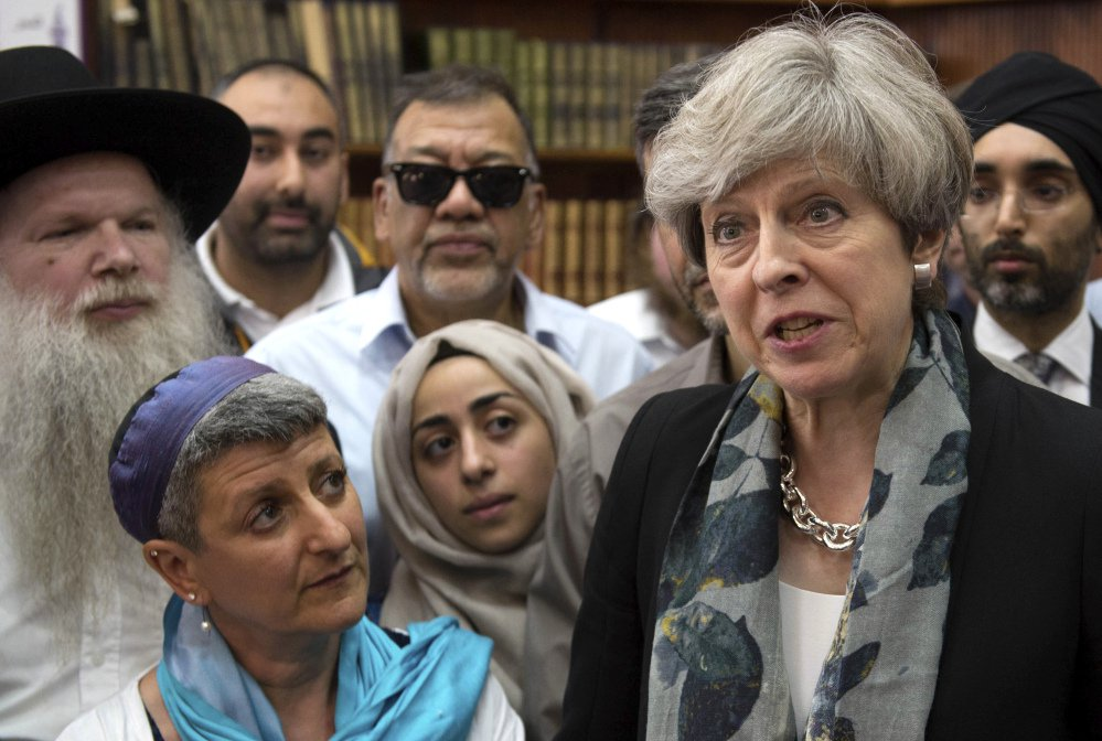 British Prime Minister Theresa May talks to faith leaders at Finsbury Park Mosque in north London, after an attack there.