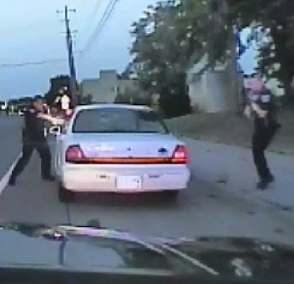 In this image made from St. Anthony Police officer Jeronimo Yanez's dashcam shows him shooting Philando Castile.