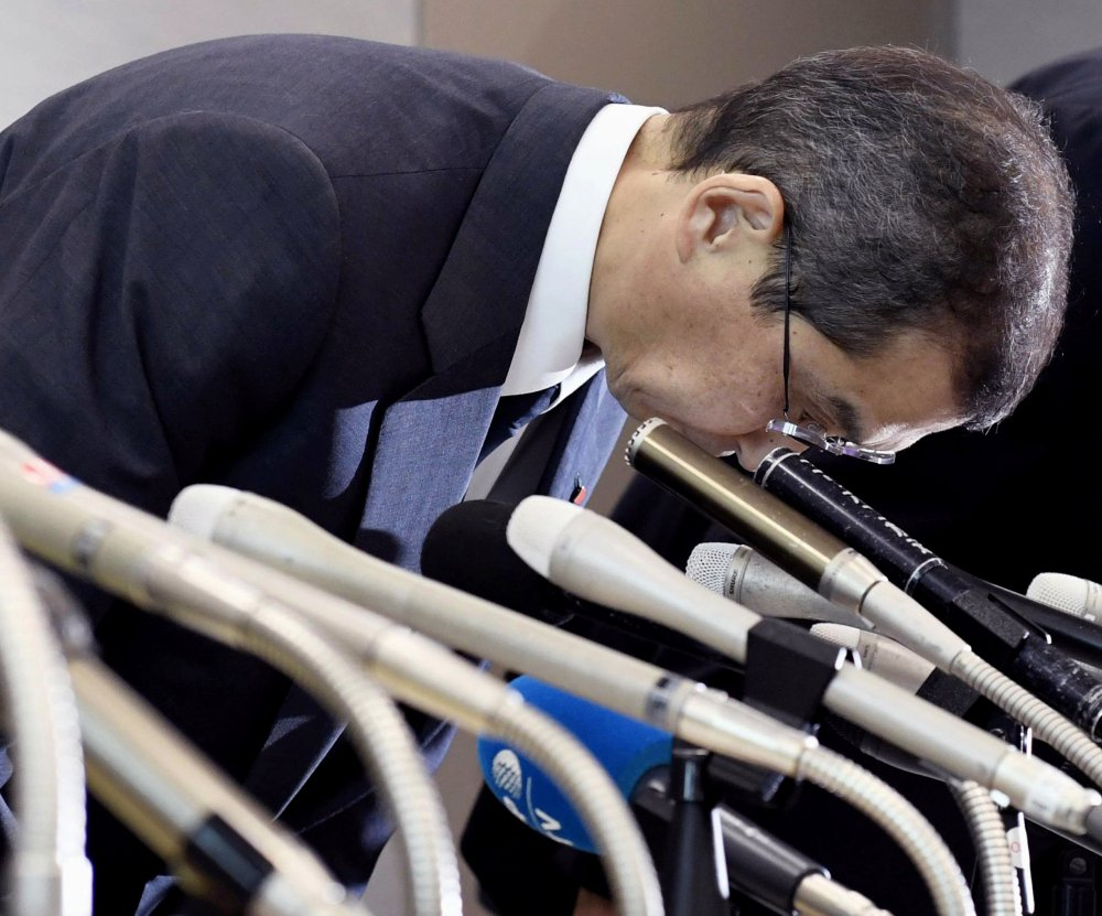 Japanese air bag maker Takata Corp. CEO Shigehisa Takada bows at the beginning of a news conference in Tokyo on Monday. Takata Corp. has filed for bankruptcy protection.