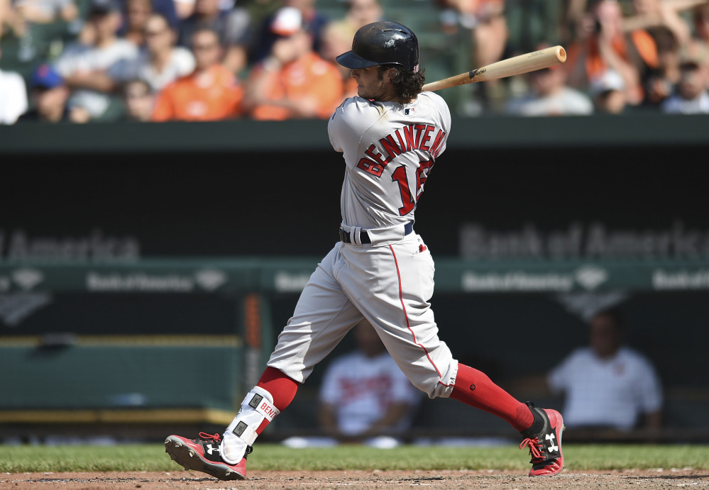 Boston Red Sox outfielder Andrew Benintendi follows through on a single against the Orioles in the ninth inning Sunday in Baltimore.